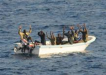 Suspected pirates keep their hands in the air as they are being apprehended by the U.S. Navy aboard the guided-missile cruiser USS Vella Gulf (CG 72) in Gulf of Aden, Somalia in this photo taken on February 11, 2009. REUTERS/Jason R. Zalasky/U.S. Navy photo/Handout