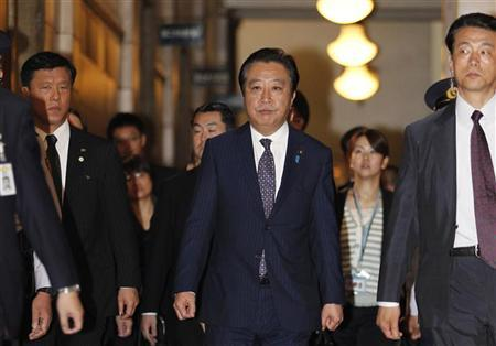 Japan's Prime Minister Yoshihiko Noda (C) leaves a lower house special session at the parliament in Tokyo June 26, 2012. REUTERS/Yuriko Nakao