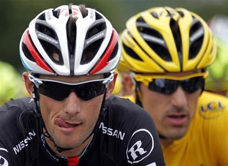 RadioShack-Nissan rider Frank Schleck (L) of Luxembourg cycles with teammate rider and leader's yellow jersey Fabian Cancellara of Switzerland during the third stage of the 99th Tour de France cycling race between Orchies and Boulogne sur mer July 3, 2012. REUTERS/Stephane Mahe