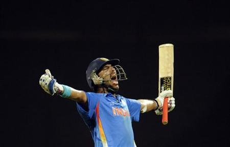 India's Yuvraj Singh celebrates after their team won the ICC Cricket World Cup final match against Sri Lanka in Mumbai April 2, 2011. REUTERS/Philip Brown/Files