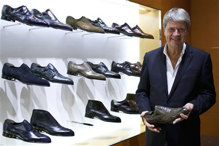 Yves Carcelle, chairman and CEO of Louis Vuitton Malletier, poses for a photograph after an interview with Reuters at the largest China LV store in Shanghai, July 17, 2012. REUTERS/Aly Song