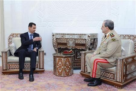 Syria's President Bashar al-Assad (L) meets with new Defense Minister, General Daoud Rajha, in Damascus August 9, 2011. REUTERS/Sana/Handout