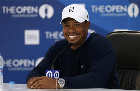 Tiger Woods of the U.S. speaks during a news conference after a practice round ahead of the British Open golf championship at Royal Lytham and St Annes, northern England July 17, 2012. REUTERS/Cathal McNaughton