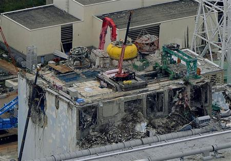 Tokyo Electric Power Co.'s (TEPCO) tsunami-crippled Fukushima Daiichi nuclear power plant reactor building number 4 is seen in Fukushima prefecture, in this aerial view photo taken by Kyodo July 18, 2012. REUTERS/Kyodo