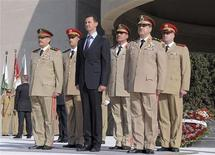 Syria's President Bashar al-Assad (C) stands with leaders of the army, including Fahad Jassim al-Freij (front L) and Daoud Rajha (front R) at the Tomb of the Unknown Soldier in a ceremony to mark the 38th anniversary of the 1973 October War with Israel, in Damascus in this October 6, 2011 file handout photo released to Reuters on July 18, 2012. REUTERS/Sana/Handout/Files
