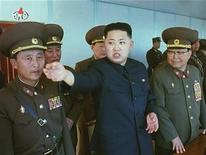 North Korea leader Kim Jong-un (C) speaks while surrounded by soldiers in this undated still image taken from video at an unknown location in North Korea released by North Korean state TV KRT on January 8, 2012. REUTERS/KRT via Reuters TV