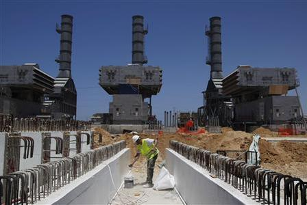 A labourer works at the construction site of Dorad, a private power plant in the southern city of Ashkelon May 17, 2012. REUTERS/Baz Ratner