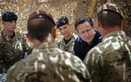 Britain's Prime Minister David Cameron (2nd R) talks to British soldiers in their base at Lashkar Gah in Helmand Province, Afghanistan July 18, 2012. REUTERS/Stefan Rousseau/Pool