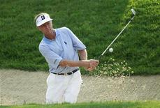 Davis Love III of the U.S. hits out from a bunker on the 11th green during the first round of the AT&T National golf tournament at Congressional Country Club in Bethesda, Maryland June 28, 2012. REUTERS/Kevin Lamarque