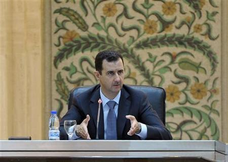 Syria's President Bashar al-Assad speaks to the new government in Damascus in this handout photo distributed by Syrian News Agency (SANA) June 26, 2012. REUTERS/SANA/Handout/Files