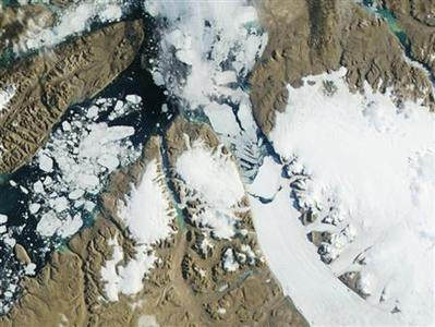 The Petermann Glacier grinds and slides toward the sea, terminating in a giant floating ice tongue, in this third in a series of three images taken by the Moderate Resolution Imaging Spectroradiometer (MODIS) on NASA's Aqua satellite along the northwestern coast of Greenland on July 16, 2012. REUTERS/NASA/Handout