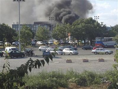 Smoke is seen after a blast at Bulgaria's Burgas airport July 18, 2012. REUTERS/Bulphoto Agency/Besove.com