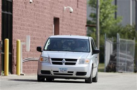 A Dodge Caravan carrying Russell Wasendorf Sr. exits from the back entrance of the United States Federal Court of the Northern District of Iowa in Cedar Rapids, Iowa July 13, 2012. REUTERS/Stephen Mally