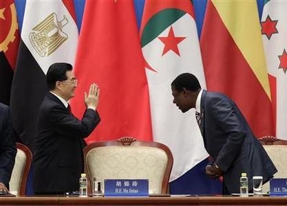 China's President Hu Jintao (L) gestures next to Benin's President Thomas Yayi Boni during the opening ceremony of the Fifth Ministerial Conference of the Forum on China-Africa Cooperation (FOCAC) at the Great Hall of the People in Beijing, July 19, 2012. REUTERS/Jason Lee