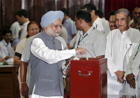 India's Prime Minister Manmohan Singh casts his vote during an election for the mainly-ceremonial post of president in New Delhi July 19, 2012. Indian lawmakers voted for a new president on Thursday, ending weeks of wrangling and opening a much-hyped political window billed as the best chance for Prime Minister Manmohan Singh to launch a wave of reforms and reverse an economic slowdown. REUTERS/Adnan Abidi