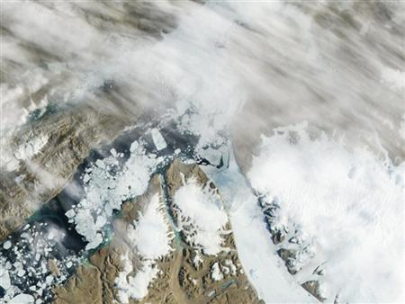 The Petermann Glacier begins to grind and slide toward the sea, terminating in a giant floating ice tongue, in this first in a series of three images taken by the Moderate Resolution Imaging Spectroradiometer (MODIS) on NASA's Aqua satellite along the northwestern coast of Greenland on July 16, 2012. REUTERS/NASA/Handout