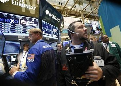 Traders work on the floor of the New York Stock Exchange, June 29, 2012. REUTERS/Brendan McDermid