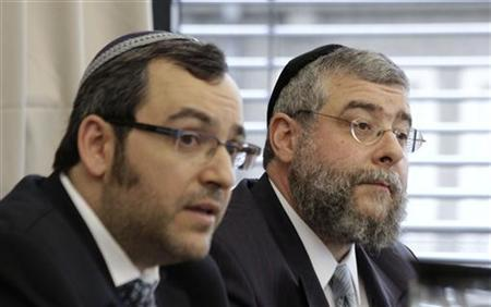 Head of the Conference of European Rabbis Pinchas Goldschmidt (R) and Rabbi Avichai Apel address a news conference after a meeting in Berlin July 12, 2012. REUTERS/Tobias Schwarz v