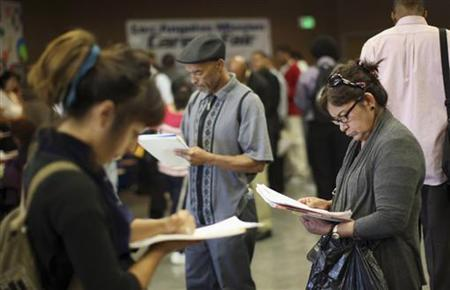 Job seekers fill out applications during the 11th annual Skid Row Career Fair the Los Angeles Mission in Los Angeles, California, May 31, 2012. REUTERS/David McNew
