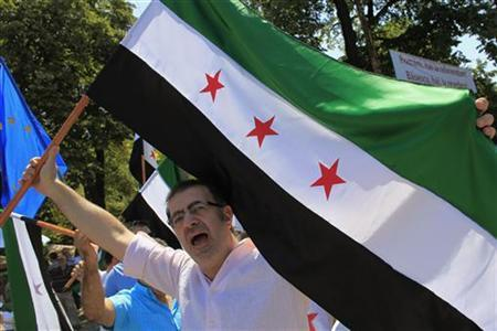 A member of the Syrian community shouts slogans against Syrian President Bashar al-Assad during a protest near the Russian embassy in Bucharest July 19, 2012. REUTERS/Radu Sigheti