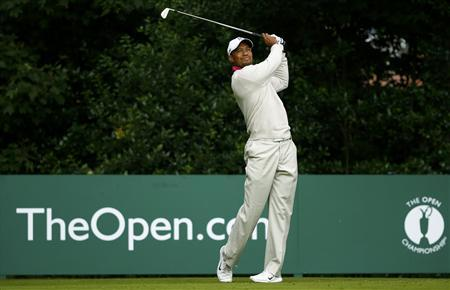 Tiger Woods of the U.S. watches his tee shot on the first hole during the first round of the British Open golf championship at Royal Lytham & St Annes, northern England July 19, 2012. REUTERS/Eddie Keogh