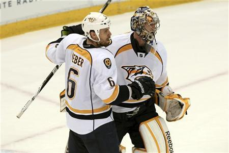 Nashville Predators defenseman Shea Weber (L) celebrates their victory over the Detroit Red Wings with Predators goalie Pekka Rinne during the third period of Game 3 of their NHL Western Conference quarter-final hockey playoff game in Detroit, Michigan April 15, 2012. REUTERS/Rebecca Cook