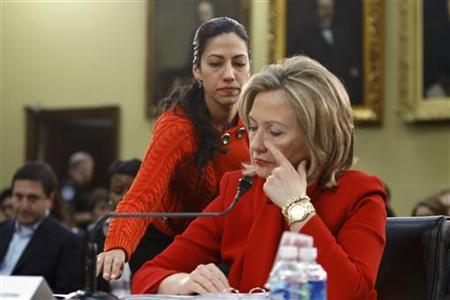 Huma Abedin, an aide to U.S. Secretary of State Hillary Clinton (C), is pictured during a House Appropriations Committee hearing on Capitol Hill in Washington, in this March 10, 2011 photograph. REUTERS/Hyungwon Kang/Files