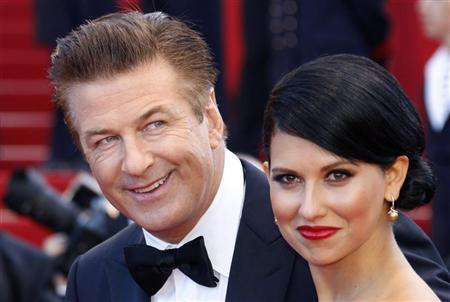 Alec Baldwin (L) and Hilaria Thomas (R) arrive on the red carpet for the screening of the film ''Moonrise Kingdom'', by director Wes Anderson, in competition at the 65th Cannes Film Festival May 16, 2012. REUTERS/Vincent Kessler