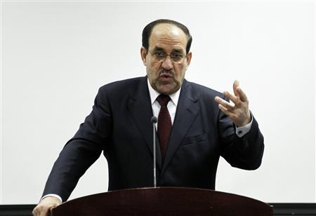 Iraq's Prime Minister Nuri al-Maliki speaks during the opening ceremony of the Defence University for Military Studies inside Baghdad's heavily-fortified Green Zone in this June 17, 2012, file photo. REUTERS/Thaier al-Sudani/Files