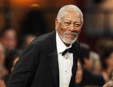 Actor Morgan Freeman stands as he is introduced at the TV Land cable channel taping of the AFI Life Achievement Award honoring actress Shirley MacLaine in Los Angeles, California in this June 7, 2012 file photograph. REUTERS/Fred Prouser/Files