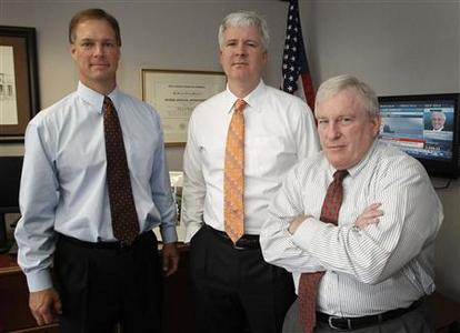 (L-R) Associate Regional Director and Enforcement Director David Peavler, Regional Director David Woodcock and Associate Regional Director for Examinations Marshall Gandy pose at the Fort Worth Regional Office of the Security Exchange Commission in Fort Worth, Texas June 28, 2012. Picture taken June 28, 2012. To match Feature SEC-FORTWORTH/ REUTERS/Mike Stone