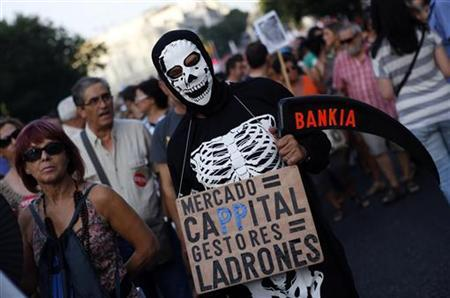 A demonstrator dresses as an skeleton during a protest against government austerity measures in Madrid July 19, 2012. REUTERS/Susana Vera