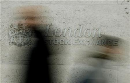 Pedestrians walk past the London Stock Exchange in the City of London December 12, 2006. REUTERS/Stephen Hird