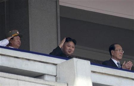 Democratic People's Republic of Korea (DPRK) leader Kim Jong-un (C) and President of the Presidium of the Supreme People's Assembly of DPRK Kim Yong-nam (R) watch a military parade to celebrate the centenary of the birth of DPRK's founder Kim Il-sung in Pyongyang April 15, 2012. REUTERS/Stringer