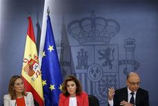 (L-R) Spain's Development Minister Ana Pastor, Spain's Deputy Prime Minister Soraya Saenz de Santamaria and Treasury Minister Cristobal Montoro attend a news conference after a cabinet meeting at Moncloa Palace in Madrid July 20, 2012. REUTERS/Susana Vera