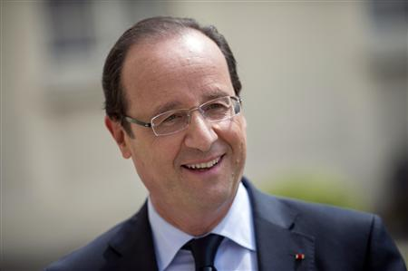 France's President Francois Hollande reacts during a visit of the Elysee Palace in Paris July 19, 2012. REUTERS/Fred/Dufour/Pool