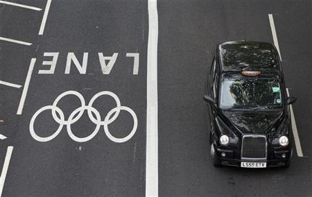 A taxi drives beside an Olympic traffic lane in Westminster, London, July 20, 2012 REUTERS/Neil Hall