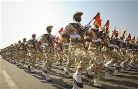 Members of the Iranian revolutionary guard march during a parade to commemorate the anniversary of the Iran-Iraq war (1980-88), in Tehran in this September 22, 2011 file photo. REUTERS/Stringer/Files