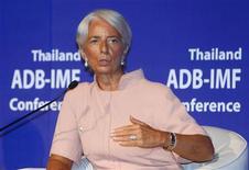 El Fondo Monetario Internacional (FMI) publicó el viernes los términos de referencia para su vigilancia del sector financiero español, pero indicó que sus valoraciones no cubrirían los planes de reestructuración de las entidades de manera individualizada. En la imagen, la directora gerente del FMI, Cristine Lagarde en una conferencia en Bangkok, el 12 de julio de 2012. REUTERS/Chaiwat Subprasom