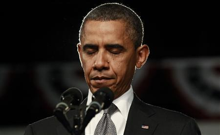 U.S. President Barack Obama during a moment of silence for the shootings in Colorado at an event in Fort Myers, Florida July 20, 2012. REUTERS/Kevin Lamarque