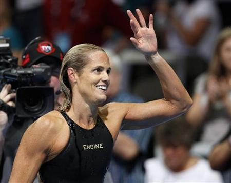 Dara Torres waves to her family after failing to qualify in the women's 50m freestyle race during the U.S. Olympic swimming trials in Omaha, Nebraska, July 2, 2012. REUTERS/Jeff Haynes