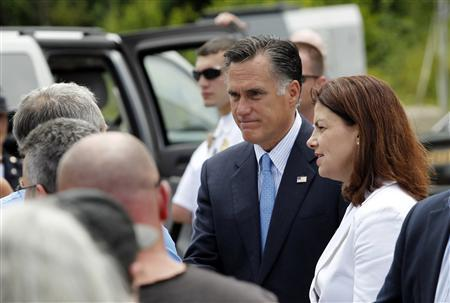 Republican presidential candidate and former Massachusetts Governor Mitt Romney and Senator Kelly Ayotte (R-NH) shake hands with supporters who formed a receiving line after Romney delivered remarks about the shooting in Colorado during what was supposed to be a campaign event at Coastal Forest Products in Bow, New Hampshire July 20, 2012. REUTERS/Jessica Rinaldi