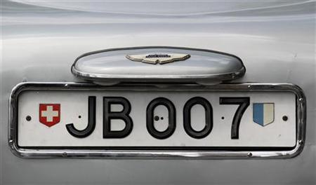 The rotating number plate on the original Aston Martin DB5, driven by actor Sean Connery in the James Bond films ''Goldfinger'' and ''Thunderball'' is displayed in London July 21, 2010. REUTERS/Suzanne Plunkett