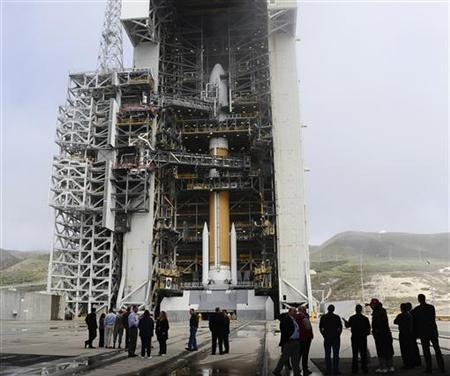 VIP's on a tour look at the United Launch Alliance (ULA) Boeing Delta 4 rocket, with a classified payload for the National Reconnaissance Office, at Vandenberg Air Force Base, California, March 28, 2012. REUTERS/Gene Blevins