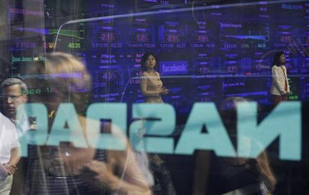 The Facebook symbol is seen on the screen inside the Nasdaq Market site in New York, May 17, 2012. REUTERS/Keith Bedford