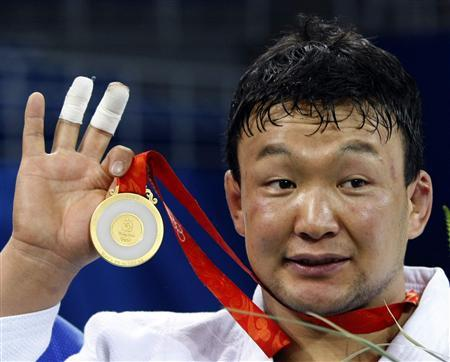 Gold medallist Tuvshinbayar Naidan of Mongolia holds his medal during the medal ceremony of the men's -100kg judo event at the Beijing 2008 Olympic Games, in this August 14, 2008 file photo. REUTERS/Kim Kyung-Hoon/Files