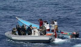 Marines from NATO's Turkish frigate Gediz arrest suspected pirates on their skiff in the Gulf of Aden July 31, 2009. REUTERS/Turkish Chief of Staff/Handout