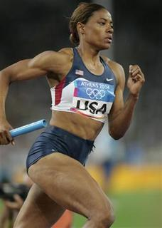 Crystal Cox of the U.S. runs during the women's 4 x 400 metres relay at the Athens 2004 Olympic Games August 27, 2004. REUTERS/Gary Hershorn