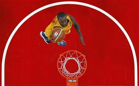 Macedonia's Lester McCalebb goes for a basket against Dominican Republic during their 2012 FIBA Olympic qualifying basketball tournament in Caracas July 6, 2012. REUTERS/Carlos Garcia Rawlins