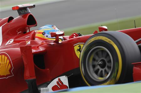 Ferrari Formula One driver Fernando Alonso of Spain steers his car during the qualifying session for the German F1 Grand Prix at the Hockenheimring in Hockenheim July 21, 2012. REUTERS/Ralph Orlowski